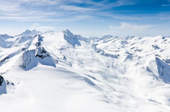 Winter mountains full of snow. Beautiful Kitzsteinhorn mountains covered with snow under blue sky in Zell Am See, Kaprun, Austria in winter time Stock Photography