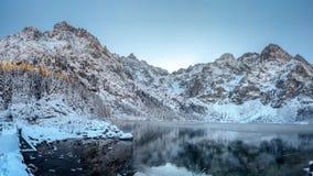 Winter mountains. High Tatra Morskie Oko lake, Poland. Scenic winter landscape of rocky mountain range covered snow stock photography