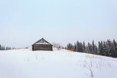 Winter, mountains, home of the shepherds, chalets Royalty Free Stock Photos