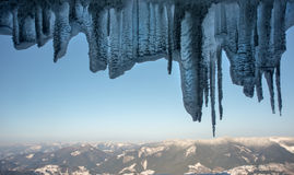 Winter mountains through ice framework Royalty Free Stock Photo