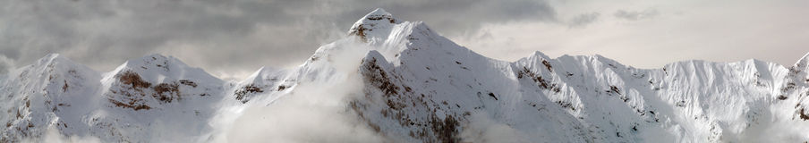 Winter mountains. Italian winter mountains, Orobie alps, in a cloudy morning Royalty Free Stock Image