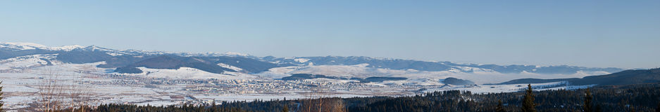 Winter mountains landscape. Panoramic view of the town Miercure Ciuc, winter Stock Photos