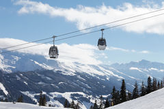 Winter mountains landscape with cable car Stock Images