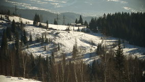 Winter mountains landscape at sunny day. Panoramic shot of winter mountains landscape at sunny day stock video footage
