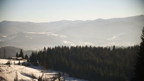 Winter mountains landscape at sunny day. Panoramic shot of winter mountains landscape at sunny day stock video