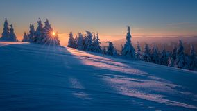 Winter mountains landscape. Trees covered with frost. Winter landscape from Slovak mountains with sun rays stock photos
