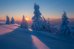 Winter mountains landscape. Trees covered with frost. Winter landscape from Slovak mountains with sun rays stock images