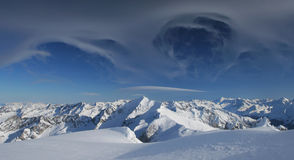Winter mountains with magic clouds Royalty Free Stock Photo