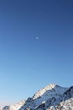 Winter mountains and moon Stock Photo