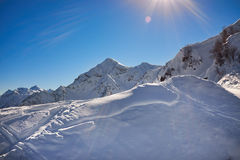 Winter mountains panorama with ski slopes. Royalty Free Stock Image
