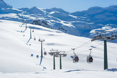 Winter mountains panorama with ski slopes and ski lifts Stock Photography