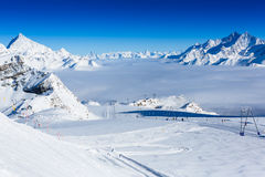 Winter mountains panorama with ski slopes and ski lifts Stock Images
