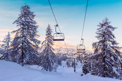 Winter mountains panorama with ski slopes and ski lifts Stock Photos