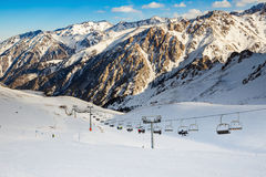 Winter mountains panorama with ski slopes and ski lifts. Royalty Free Stock Image