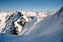 Winter mountains. Panorama of snowy peaks in Polish Tatra mountains royalty free stock photography