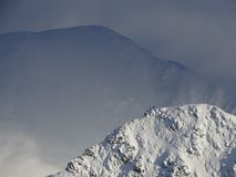 Winter mountains in Scotland. 4 climbers starting their descent stock photography