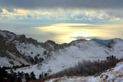 Winter, mountains and sea Stock Photography
