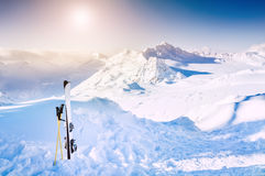 Winter mountains and ski equipment in the snow Royalty Free Stock Photo