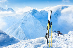 Winter mountains and ski equipment in the snow Royalty Free Stock Photos