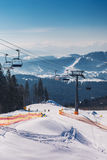 Winter mountains with ski slopes and ski lifts Stock Photo