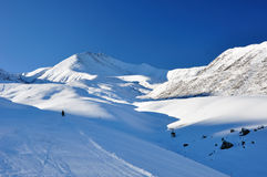 Winter in mountains with skier Royalty Free Stock Photos