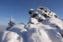 Winter mountains. Snow-covered rocky peak in the Giant Mountains Stock Photos