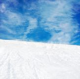 Winter mountains snow slope and blue sky Stock Image