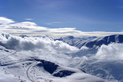 Winter in the mountains of Turkey. Bright white Clouds and snow mounains (Turkey royalty free stock photo