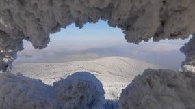 Winter mountains. View frosted window to the wooded ridge Jizera Mountains Stock Photos