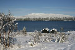 Winter in mountian area. Winter in a Norwegian mountain area with a lake Stock Photos