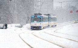 Winter. Movement of the tram during snowfall. Royalty Free Stock Images
