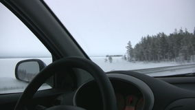 Winter. Moving car Stock Images