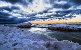 Winter. Mystical sunset be the sea on cold winter day Royalty Free Stock Photography