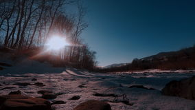 Winter nature landscape. Snowy forest, tree and a sunset. Timelapse round. Karpaty Ukraine stock video footage