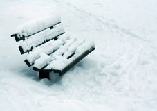 Winter landscape, snowy bench in park Royalty Free Stock Photo