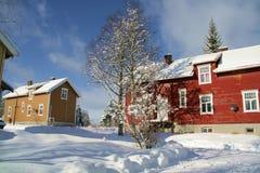 Winter neighborhood. Old houses in a snowy neighborhood in Norway royalty free stock images