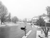 Winter neighborhood. B&W pic of a neighborhood while snowing Royalty Free Stock Photography