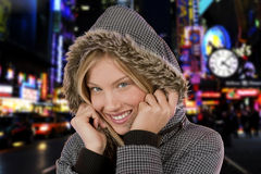 Winter in New York. Beautiful young woman, Manhattan in the background Royalty Free Stock Photos
