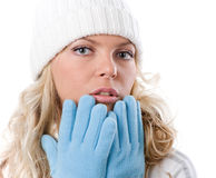 Winter nice girl in white hat and blue gloves Stock Photos