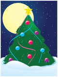 Winter night. With beautifully decorated christmas tree Royalty Free Stock Image