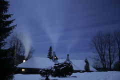 Winter night. A lonly house is standing on a moonlight Royalty Free Stock Images
