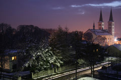 Winter by night. Winter city by night, church, street, snow and lights Royalty Free Stock Photo