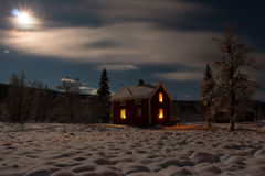 Winter night cabin. A lonely winter cabin in north of sweden Stock Photos