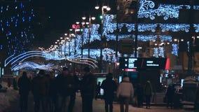 Winter. Night city. A lot of people walking on the street. Twinkle light decoration of the city. Ukraine, city of Kiev stock video