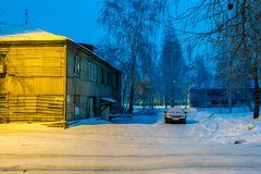In the urban slums. On a winter night in December in the city`s slums, where there are lighted lampposts Stock Image