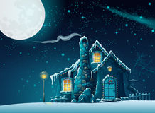Winter night with a fabulous home in the moonlight Royalty Free Stock Photo