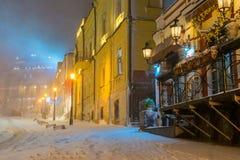 Winter night landscape, evening in the night snowy street under snowfall. Evening in the night snowy street under snowfall royalty free stock images