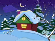 Winter night landscape. The house with a chimney. The smoke from the chimney. Freezing day. New Year`s and Christmas. Christmas Eve. All homes are vsbore Stock Images