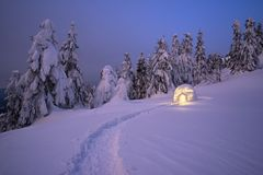 Winter night landscape with a snow igloo. Night landscape with a snow igloo with light. Extreme house. Winter in the mountain Stock Photography