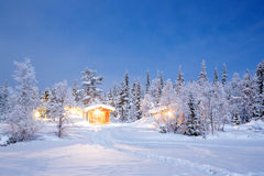 Winter Night Lapland Sweden. Winter landscape with cabin hut at night in Kiruna Sweden at Night with star trail Stock Image